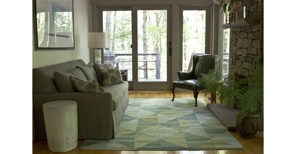 Montagne Handwoven geometric strip rug in green with triangle detail. Hand-dyed. 100% natural wool and cotton fibers with latex backing. Handmade in USA.