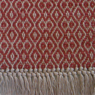 A pretty fringe detail finishes this custom Montagne Handwoven rug.