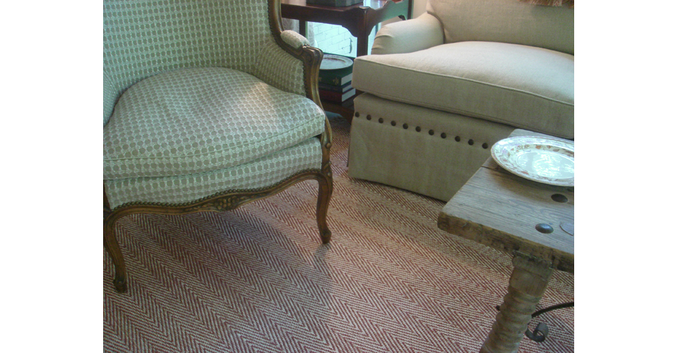 Montagne Handwoven handmade twill rug in rust and white with chevron stripe detail.