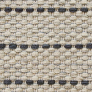 Custom handmade rug by Montagne Handwoven. Texture Weave pattern rug in white with navy stripe
