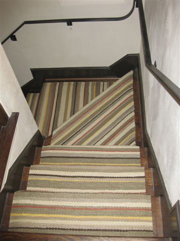 Montagne Handwoven handmade flat weave rug in earthtones with stripe detail. Custom woven to accommodate staircase