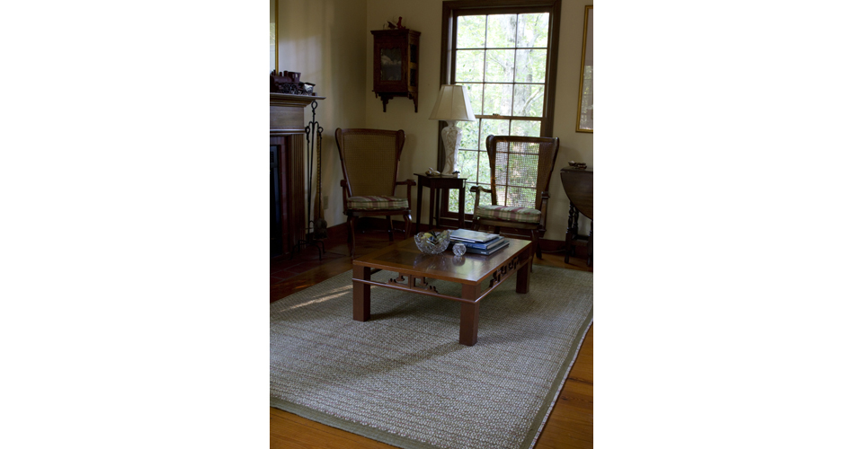 Montagne Handwoven warp & weft rug with multicolor warp detail. Hand-dyed. 100% natural wool fibers with latex backing. Handmade in USA.